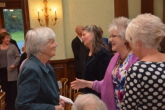 Patron Monica Moreton MBE is greeted by Chair Anne Bird and Vice Chair Janet Markwell